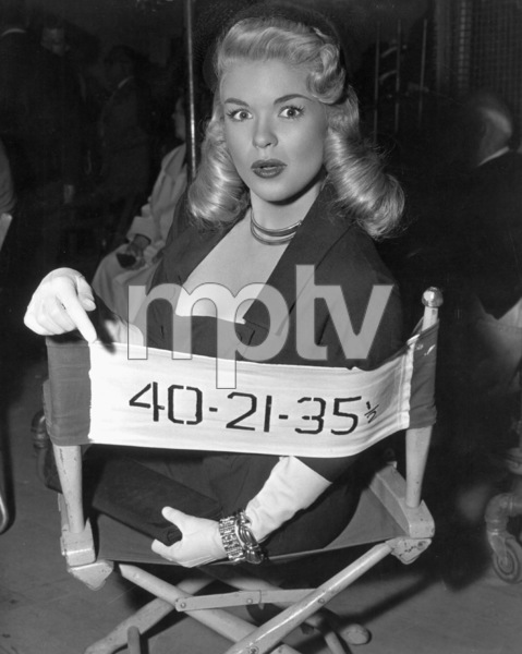 """Jayne Mansfield proudly points to her chair on the set of """"Illegal""""1955 © 1978 Pat Clark - Image 0774_0017"""