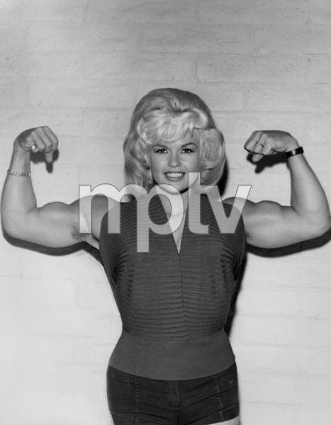 Jayne Mansfield posing in front of her husband Mickey Hargitay flexing his musclesCirca 1960 © 1978 Eric Skipsey - Image 0774_0619