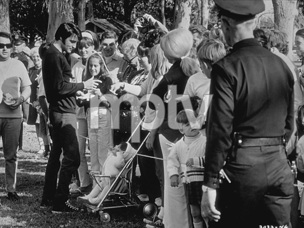 "Elvis Presley signing autographsduring a break from ""Change of Habit""1969 Universal - Image 0818_0092"