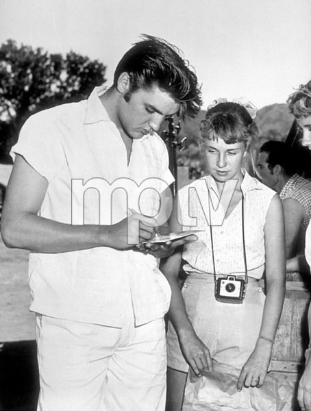 Elvis Presley signing autographs for his fanscirca 1957 - Image 0818_0115