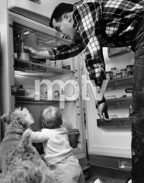 Jack Lemmon at home with son Chris and dog DuffyMay 10, 1955 © 1978 Sid Avery - Image 0894_0169