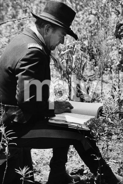 """John Wayne preparing for a scene in """"Rio Lobo,"""" Cinema Center 1970. © 1978 David Sutton - Image 0898_1116"""