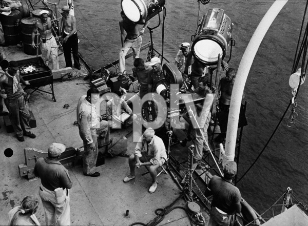 "John Wayne and director, John Farrow, on location for ""The Sea Chase,"" Warner Bros. 1955. - Image 0898_2090"