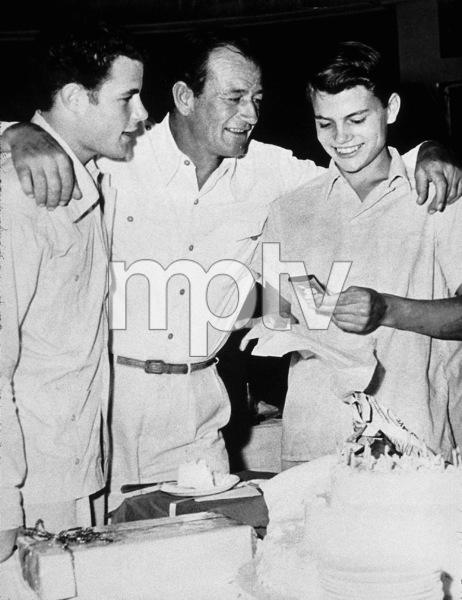 "John Wayne with his sons, Michael and Patrick, on the set of ""Hondo,"" Warner Bros. 1953. - Image 0898_2996"