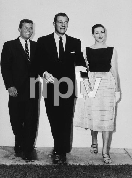 "John Wayne with his son, Patrick, and his daughter, Antonia Maria (""Toni""), circa 1957 - Image 0898_2998"