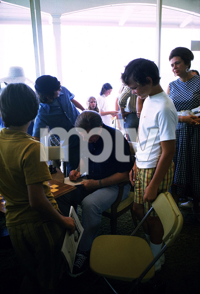 John Wayne signing autographs for fans at the Balboa Bay Club, 1972. © 1978 David Sutton - Image 0898_3049