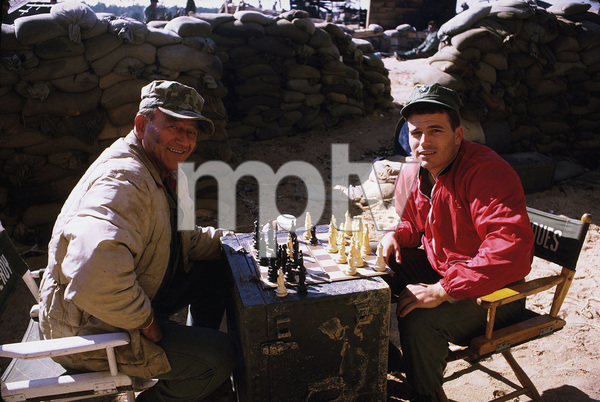 """John Wayne playing chess with his son, Patrick, during a break from filming """"The Green Berets,"""" Warner Bros. 1967. © 1978 David Sutton - Image 0898_3051"""