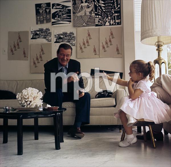 John Wayne and daughter Aissa at home on Louise Street in Encino, California1958 © 1978 Bernie Abramson - Image 0898_3103