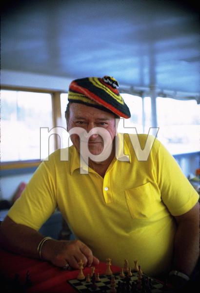 "John Wayne on his yacht, ""Wild Goose,"" 1971. © 1978 David Sutton - Image 0898_3108"