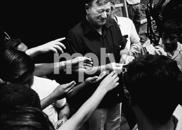 John Wayne signing autographs for fans, circa 1970. © 1978 David Sutton - Image 0898_3139