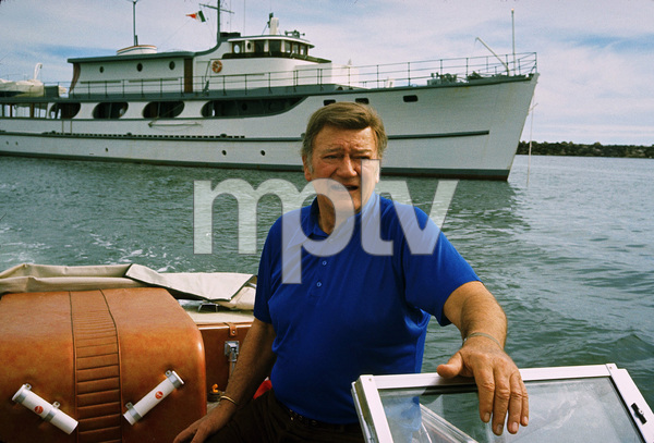 "John Waybne in front of his yacht, ""Wild Goose,"" 1971. © 1978 David Sutton - Image 0898_3233"