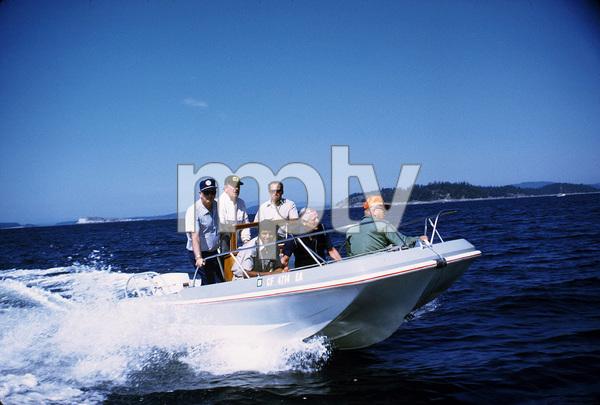 John Wayne, Ken Reafsnyder, Jack Gordean, and Jim Cunningham on a speedboat between Vancouver and Alaska, 1971. © 1978 David Sutton - Image 0898_3235