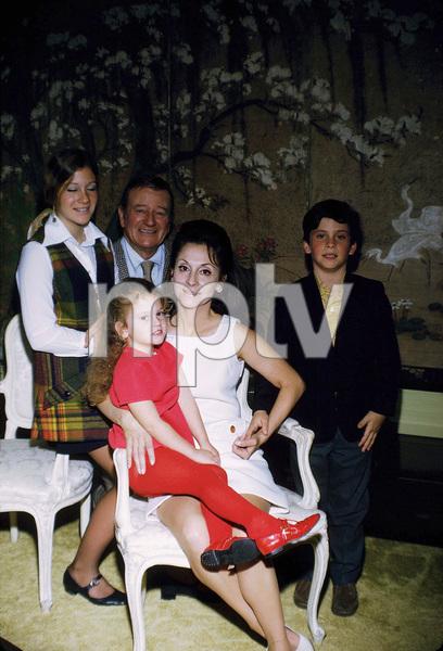John, Aissa, Marisa, Pilar, and Ethan Wayne at home, 1970. © 1978 David Sutton - Image 0898_3257