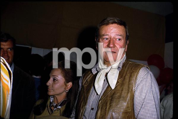 John Wayne and his wife, Pilar, at a Share Party, 1970. © 1978 David Sutton - Image 0898_3273