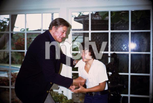 John Wayne and his son, Ethan, at home, 1972. © 1978 David Sutton - Image 0898_3285