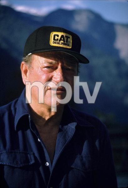"John Wayne on his yacht, ""Wild Goose,"" 1971. © 1978 David Sutton - Image 0898_3300"