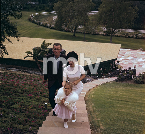 John Wayne with his wife Pilar and daughter Aissa at home on Louise Street in Encino, California1958 © 1978 Bernie Abramson - Image 0898_3401