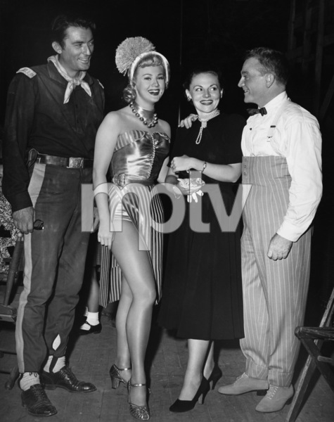 "James Cagney with sister Jeanne Cagney, Gregory Peck (relaxing during a break in his Warner film, ""Only the Valiant"") and Virginia Mayo at Warners while ""The West Point Story"" was shooting1950 Warner BrothersPhoto by Mac Julian - Image 0969_0037"