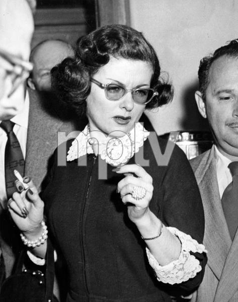 Joan Bennett leaving hospital after film producer husband, Walter Wanger, shot her agent, Jennings Lang, in a jealous rage, 2/24/52, I.V. - Image 0994_0038