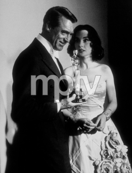 """""""Academy Awards: 30th Annual,"""" Cary Grant and Jean Simmons. 1958. © 1978 Sid Avery - Image 10764_0026"""