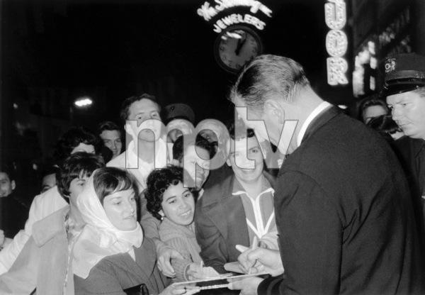 """How the West Was Won"" Premiere, 1962John Wayne signing autographs © 1978 Chester Maydole - Image 11171_0009"