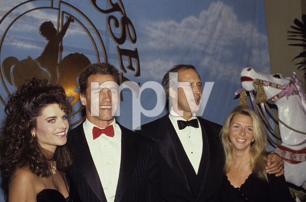 "Arnold Schwarzenegger and Maria Shriver with Chevy Chase and his wife Jayni at a ""Carousel of Hope Ball""1990 © 1990 Gunther - Image 11937_0016"