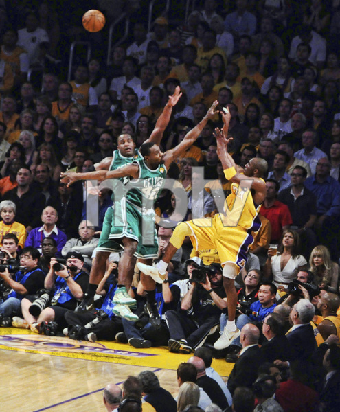 Kobe Bryant of the Los Angeles Lakers doing a turnaround jumper over Glen Davis and Tony Allen of the Boston Celtics at game 7 of the NBA finals2010 © 2010 Michael Jones - Image 11981_0006