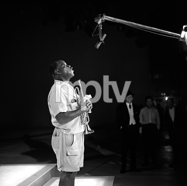 """""""The Frank Sinatra Timex Show"""" (Bing Crosby and Dean Martin Present High Hopes) Louis Armstrong rehearsing for an ABC Television Special as Frank Sinatra looks on 1959 © 1978 Gene Howard - Image 1198_0031"""
