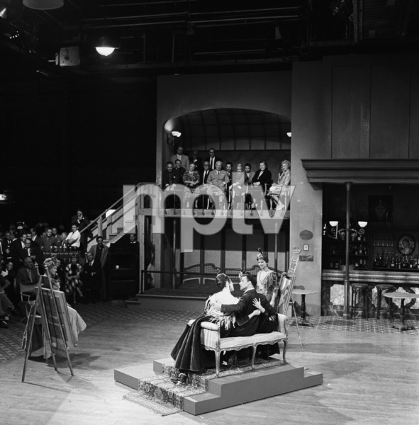 "Nikita Khrushchev watches on as Frank Sinatra performs on the set of the film ""Can-Can"" at 20th Century Fox"