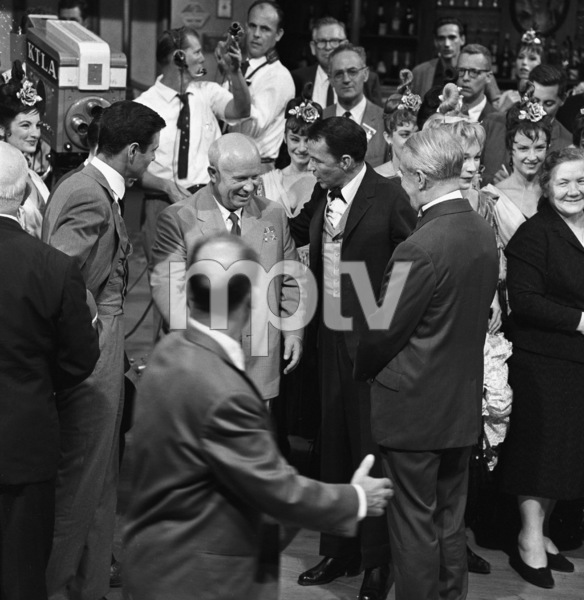 "Nikita Khrushchev visits with Frank Sinatra, Maurice Chevalier, Louis Jourdan and Shirley MacLaine on the set of the film ""Can-Can"" at 20th Century Fox"