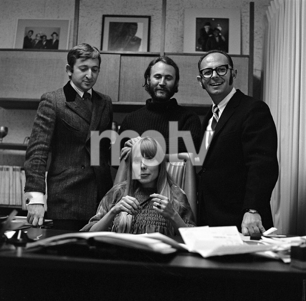Joni Mitchell at contract signing with Warner Brothers record executive Mo Ostin standing over her left shoulder, Elliot Roberts over her right, and David Crosby, directly behind her 1967 © 1978 Ed Thrasher - Image 12614_0012