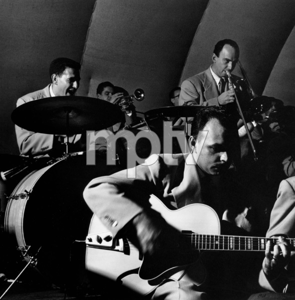 Stan Kenton Orchestra: Shelly Manne (drums), Maynard Ferguson (trumpet), Laurindo Almeida (guitar), and Milt Bernhart (trombone) in Balboa 1950 © 1978 Bob Willoughby - Image 13360_401