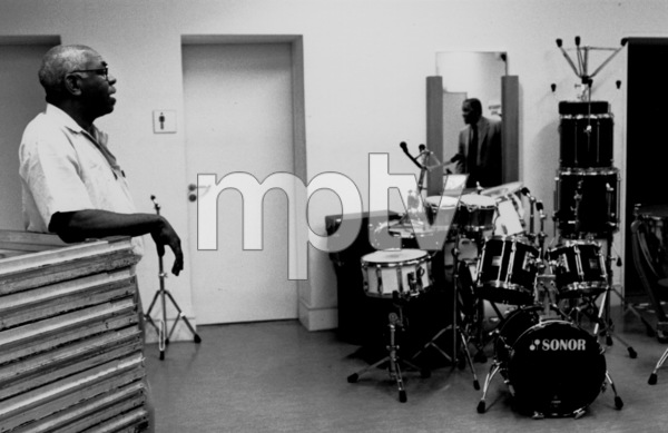 "Connie Kay and John Lewis (mirror reflection) backstage at the ""Jazz Gipfel"" concert, Stuttgart, Germany, 1992. © 1978 Bob Willoughby / MPTV - Image 13374_33"