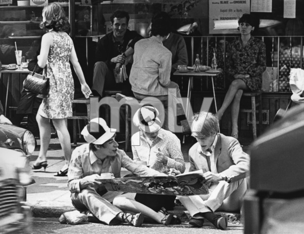 """Beatniks""When seats are unavailable at the outdoor cafe, curbside will do quite well thank you on Kings Road / September 2, 1967 - Image 13781_0001"