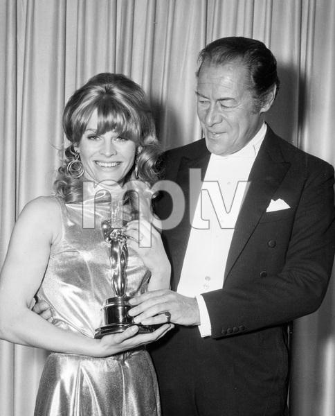 Julie Christie receiving her Best Actress Oscar for DARLING from Rex Harrison, 1966, I.V. - Image 13798_0006