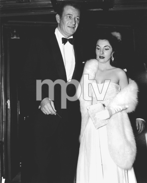 John Wayne with wife Pilar Academy Awards: 26th Annual, 1954.**I.V. - Image 17172_0020