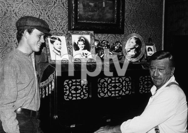 """The Shootist,"" Paramount 1976.Ron Howard and John Wayne. © 1978 David Sutton - Image 1797_0004"