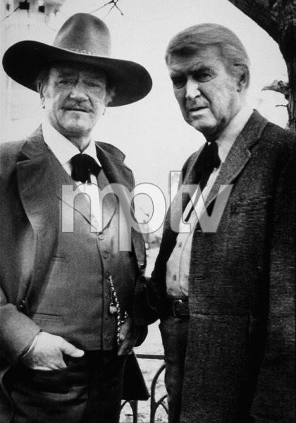 """""""The Shootist,"""" Paramount 1976.John Wayne and James Stewart. © 1978 David Sutton - Image 1797_0011"""
