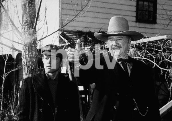 """The Shootist,"" Paramount 1976.Ron Howard and John Wayne. © 1978 David Sutton - Image 1797_0015"