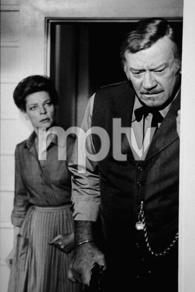 """The Shootist,"" Paramount 1976.Lauren Bacall and John Wayne. © 1978 David Sutton - Image 1797_0018"