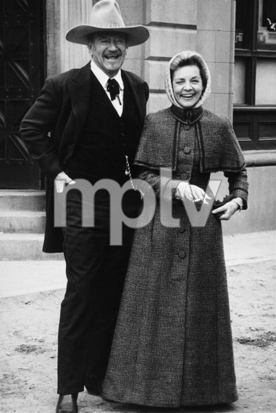 """The Shootist,"" Paramount 1976.John Wayne and Lauren Bacall. © 1978 David Sutton - Image 1797_0019"