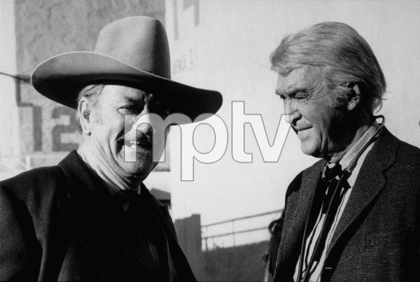 """""""The Shootist,"""" Paramount 1976.John Wayne and James Stewart. © 1978 David Sutton - Image 1797_0021"""