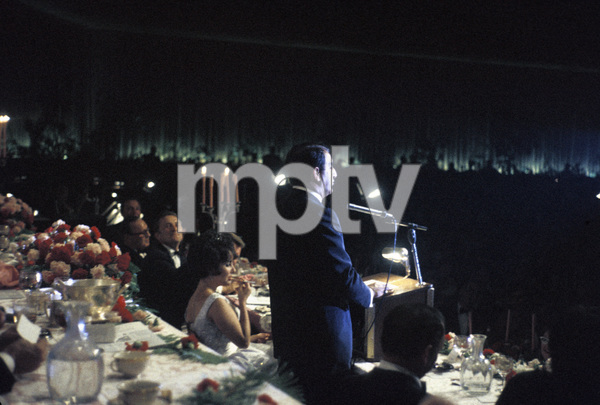 """Cedars-Sinai Benefit / Party""(at microphone) Danny Thomas (seated to his left) Elizabeth Taylor, Robert F. Kennedy, Kirk Douglas, Jack Bennycirca 1961 / The Beverly Hilton © 1978 David Sutton - Image 1807_0001"