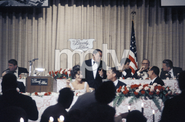 """Cedars-Sinai Benefit / Party""(left to right) Peter Lawford, Elizabeth Taylor, Frank Sinatra, Robert F. Kennedy, Eddie Fisher, Jack Benny, unknown, Kirk Douglascirca 1961 / The Beverly Hilton © 1978 David Sutton - Image 1807_0018"