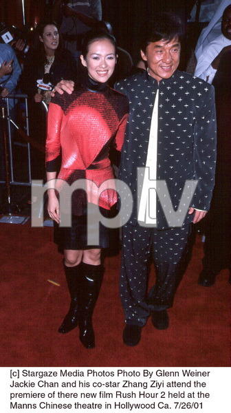 Jackie Chan and his co-star Zhang Ziyi attend the premiere of there new film Rush Hour 2 held at the Manns Chinese theatre in Hollywood Ca. 7/26/01. © 2001 Glenn Weiner - Image 18861_0110