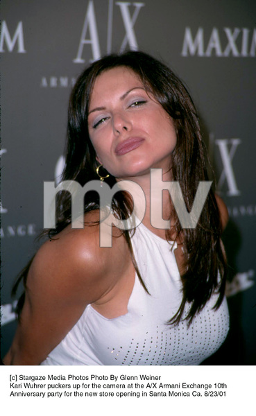 Kari Wuhrer puckers up for the camera at the A/X Armani Exchange 10th Anniversary party for the new store opening in Santa Monica Ca. 8/23/01. © 2001 Glenn Weiner - Image 19279_0111