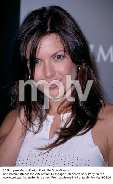 Kari Wuhrer attends the A/X Armani Exchange 10th Anniversary Party for the new store opening at the third street Promenade mall in Santa Monica Ca. 8/23/01. © 2001 Glenn Weiner - Image 19279_0112