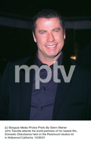 John Travolta attends the world premiere of his newest film, Domestic Disturbance held on the Paramount studios lot in Hollywood California. 10/30/01. © 2001 Glenn Weiner - Image 19661_0113