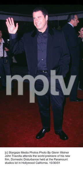 John Travolta attends the world premiere of his newfilm, Domestic Disturbance held at the Paramountstudios lot in Hollywood California. 10/30/01. © 2001 Glenn Weiner - Image 19661_0115
