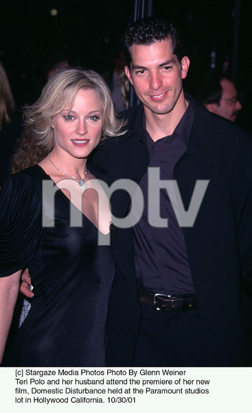 Teri Polo and her husband Tony Moore attend the premiere of her new film, Domestic Disturbance held at the Paramount studios lot in Hollywood California. 10/30/01. © 2001 Glenn Weiner - Image 19661_0126